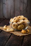 Dried figs in glass bowl on wooden background. Royalty Free Stock Images