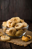Dried figs in glass bowl on wooden background. Stock Photos