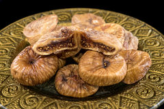 Dried figs. In golden plate royalty free stock image