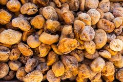Dried figs in large quantity, vegetative background stock photos