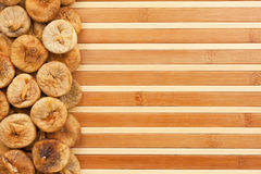 Dried figs  lying on a bamboo mat Stock Photo