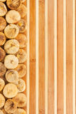 Dried figs lying on a bamboo mat Royalty Free Stock Photos