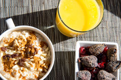 Dried figs, oatmeal and orange juice breakfast setting Royalty Free Stock Photo