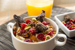 Dried figs, oatmeal and orange juice breakfast setting Royalty Free Stock Photography