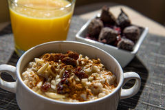 Dried figs, oatmeal and orange juice breakfast setting Stock Images