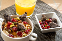Dried figs, oatmeal and orange juice breakfast setting Stock Photo
