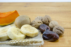 Dried figs, palms, pumpkins, wheat with walnuts and kiwis Royalty Free Stock Photo