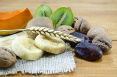 Dried Figs, Palms, Pumpkins, Wheat With Walnuts And Kiwis Royalty Free Stock Images