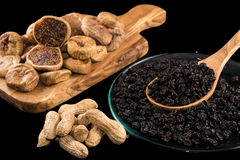 Dried figs, peanuts and raisins Royalty Free Stock Photos