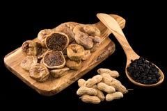 Dried figs, peanuts and raisins Stock Photos