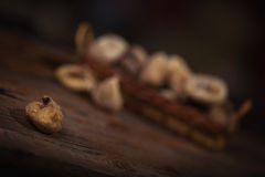 Dried figs in a small basket on wooden background Stock Image