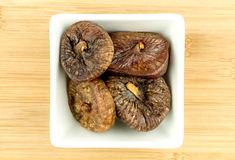 Dried figs in white bowl Stock Photography
