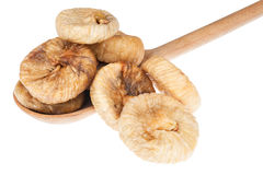Dried figs in a wooden spoon Royalty Free Stock Image