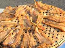 Dried fish on the bamboo grid Stock Photo
