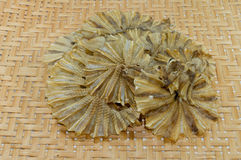 Dried fish on  basketwork background Stock Image