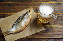 Dried fish and beer Royalty Free Stock Images