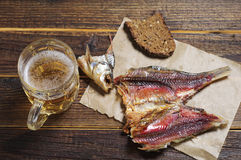 Dried fish and beer Royalty Free Stock Photography