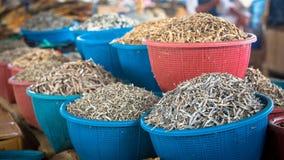 Dried fish on fish marketplace. Fishing baskets with dried fish on a fish marketplace  in flores, indonesia Stock Image
