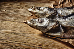 Dried fish lying on the table royalty free stock image