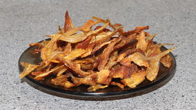 Dried fish in a plate. Fried dried fish ready for serving Stock Photography