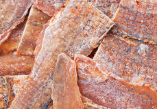 Dried fish sated snack. With pepper closeup background Royalty Free Stock Photos
