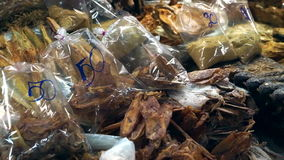 Dried fish seafood in South East Asia market stall stock video footage