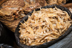 Dried fish. Some bags of dried fish on a market on the Inle Lake of Myanmar, Southeast Asia Stock Photo