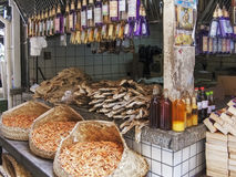 Dried fish and spirits at the market Stock Photos
