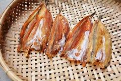 Dried Fish on threshing basket Royalty Free Stock Photography