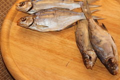 Dried fish. On a wooden board Royalty Free Stock Images