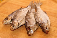 Dried fish. On a wooden board Royalty Free Stock Image
