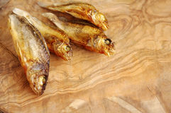 Dried fish on a wooden board Stock Photography
