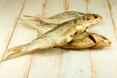 Dried fish on the wooden table Stock Photos
