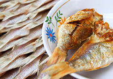 Dried fishs. Fried fish for customer tasting Stock Image
