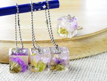 Dried flower in crystal clear resin royalty free stock photos