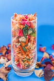 Dried flower decoration. Bowl with dried flowers decoration on blue background Stock Photography