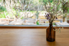 Dried flower vase on wooden table Stock Photos