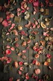 Dried flowers background. Vintage dried colored flowers on old wooden table royalty free stock image