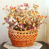Dried flowers in a basket. Winter bouquet stock photography