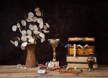 Dried flowers in ceramic vases and jewelry in a box Stock Photos