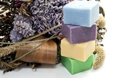 Dried flowers and colorful soap Stock Photos