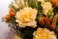 Dried flowers in the foreground, bouquets of dried flowers, flower arrangement. Floral arrangement of dried flowers in a vase, household dried flowers, flash Stock Image
