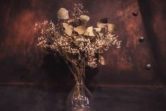 Dried flowers in a glass jar stock image