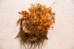 Dried flowers and herbs on the wall. Ornamental dried flowers and herbs on the wall, interior design for home and vintage house royalty free stock photography