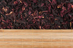Dried flowers of hibiscus and bamboo mat Royalty Free Stock Photo