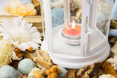 Dried flowers with lamp and candle Royalty Free Stock Photos