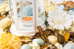 Dried flowers with lamp and candle Stock Photography