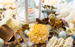 Dried flowers with lamp and candle Stock Image