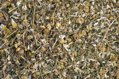 Dried flowers and leaves of chamomile in open-air market Stock Photos