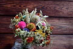 Dried flowers and plants for home design. Bouquet of dried flowers to decorate your home royalty free stock photo